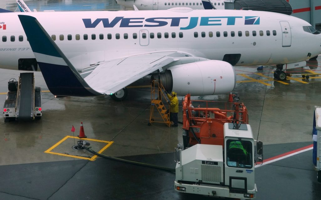 Westjet Boeing 737-700 being refueled from a ramp hydrant through a pump truck at YYZ