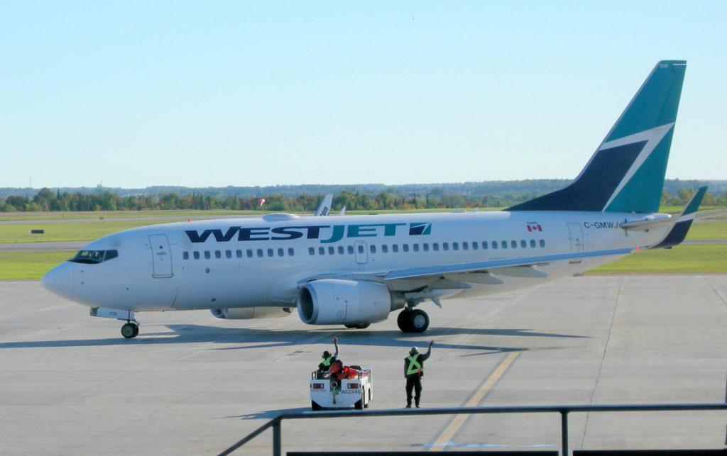 "Westjet ""rampies"" wave goodbye after a quick turnaround at Ottawa YOW"