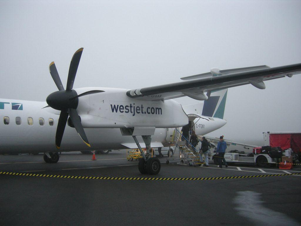Boarding WS3102 on a foggy YVR morning.