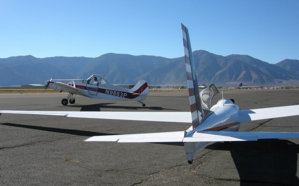 The tow plane moves into position in front of the Schweizer 2-32